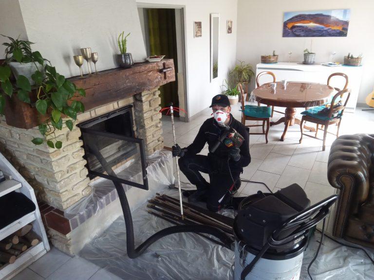Décapage d'un conduit de cheminée